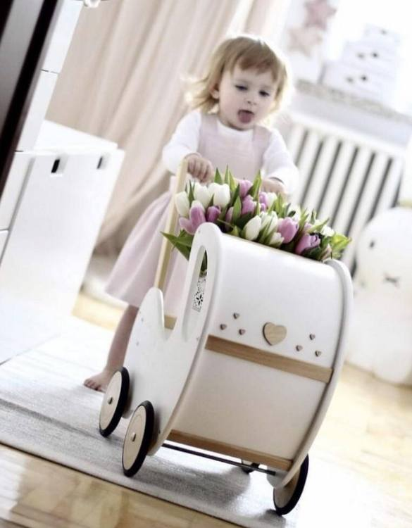 Perfect for taking dolly or teddy for a walk, the Handmade Wooden Doll Pram White & Natural Wood Nat Decor will parkle your child's imagination and create hours and hours of play! This gorgeous wooden pram is perfect for little girls to take their favourite dolls for a ride, it has rubber wheels and is suited to younger children.