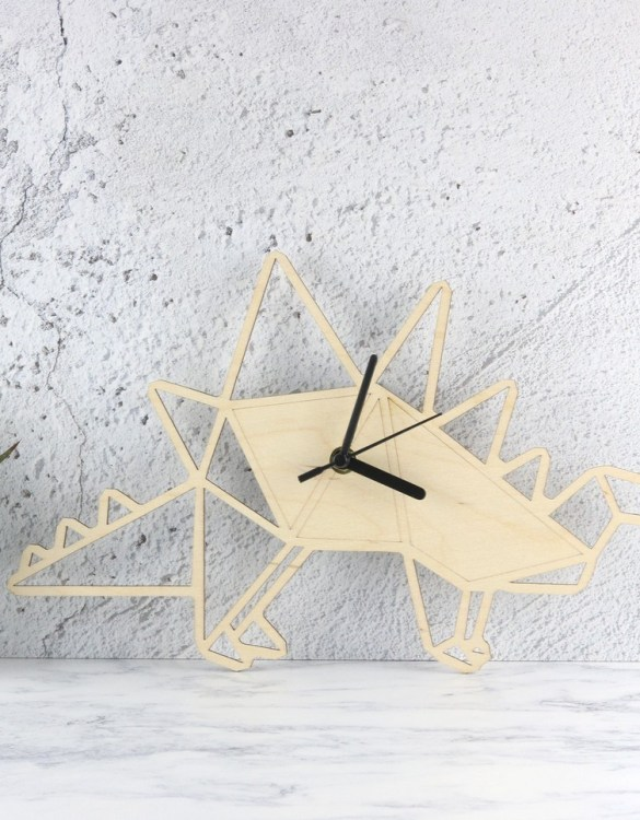 Can be hung up on a wall or placed on a shelf the Decorative Wall Clock - Geometric Stegosaurus will make learning to tell the time lots of fun for young children. This bedroom wall clock looks amazing on the wall of a daughter, son, grandchild, or godchild's playroom, bedroom or nursery.