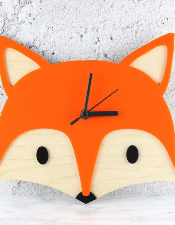 Can be hung up on a wall or placed on a shelf the Decorative Wall Clock - Woodland Fox will make learning to tell the time lots of fun for young children. This bedroom wall clock looks amazing on the wall of a daughter, son, grandchild, or godchild's playroom, bedroom or nursery.