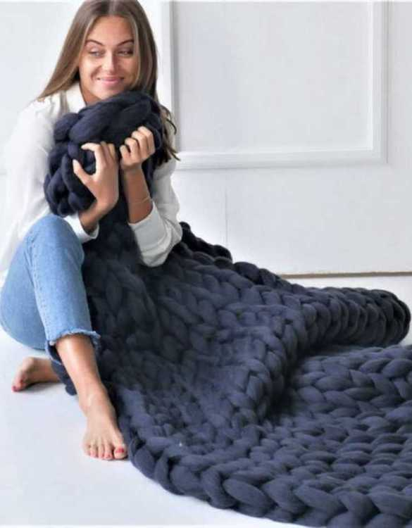 Super soft, the Navy Chunky Knit Blanket is the perfect addition for any contemporary home and makes it perfect for naps or night time.