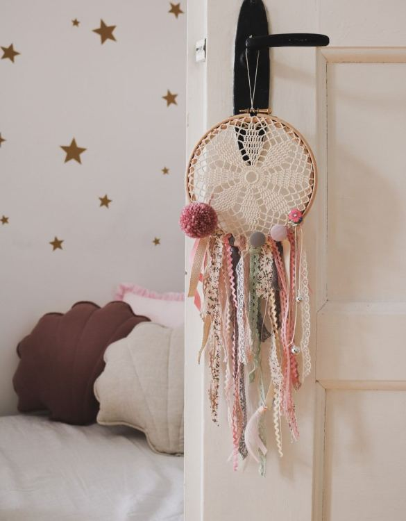 Perfect for a nursery or child's bedroom, the Ballerina Handmade Dream Catcher looks great as a new baby gift or to hang in the baby's nursery. Dream catchers are totems that represent good energy, and neutralize negative energy at home.