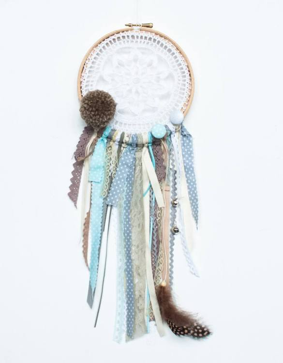 Perfect for a nursery or child's bedroom, the Indian Handmade Dream Catcher looks great as a new baby gift or to hang in the baby's nursery. Dream catchers are totems that represent good energy, and neutralize negative energy at home.