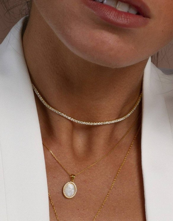 With a sleek, minimal and contemporary design, the Riviere Gold Necklace is the perfect everyday accessory for effortless elegance. This special sterling silver necklace has been designed to represent happiness, so whoever wears can be set on the path to joy.