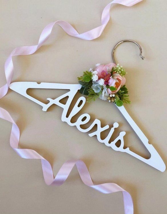 A beautiful way to display tiny clothes and make a wonderful keepsake, the Custom Bridal Dress Hanger is a lovely little extra for your baby's clothes. A wonderfully unique children's clothes hanger, it is perfect for hanging up their favourite outfit or simply as a wall decoration in their own right.