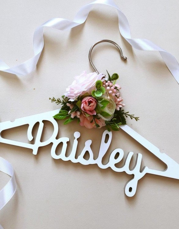 A beautiful way to display tiny clothes and make a wonderful keepsake, the Floral Personalised Kids Clothes Hanger is a lovely little extra for your baby's clothes. A wonderfully unique children's clothes hanger, it is perfect for hanging up their favourite outfit or simply as a wall decoration in their own right.