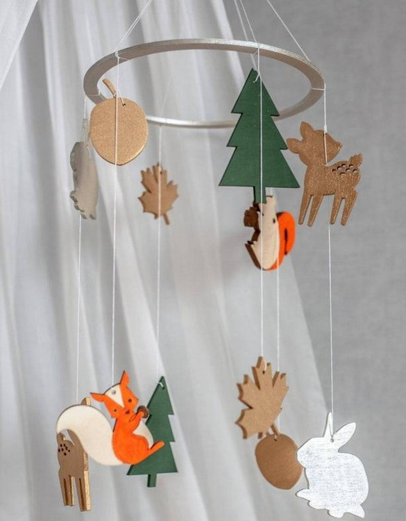 A perfect addition to any baby's room, the Forest Wooden Baby Mobile enchants children's eyes and escorts them into the land of dreams. This enchanting neutral gender baby mobile is sure to delight any child and will make the cutest addition to a woodland themed nursery decor.