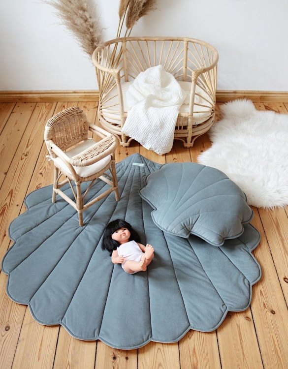 Soft and squishy, the Gray Mint Velvet Shell Mat is a wonderful gift for a little one. Ideal for babies learning to roll around and for small children to sit and play. This quilted mat will be a piece to grow and adapt to your child's needs.