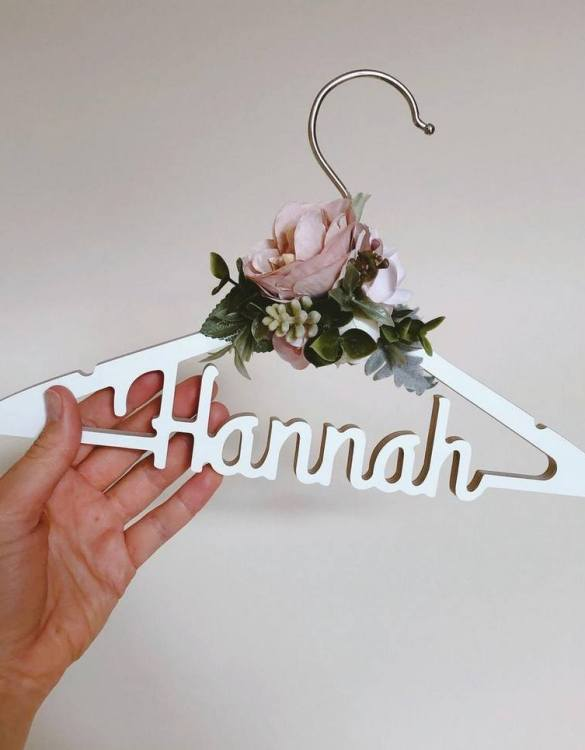 A beautiful way to display tiny clothes and make a wonderful keepsake, the Personalised Christening Dress Hanger is a lovely little extra for your baby's clothes. A wonderfully unique children's clothes hanger, it is perfect for hanging up their favourite outfit or simply as a wall decoration in their own right.