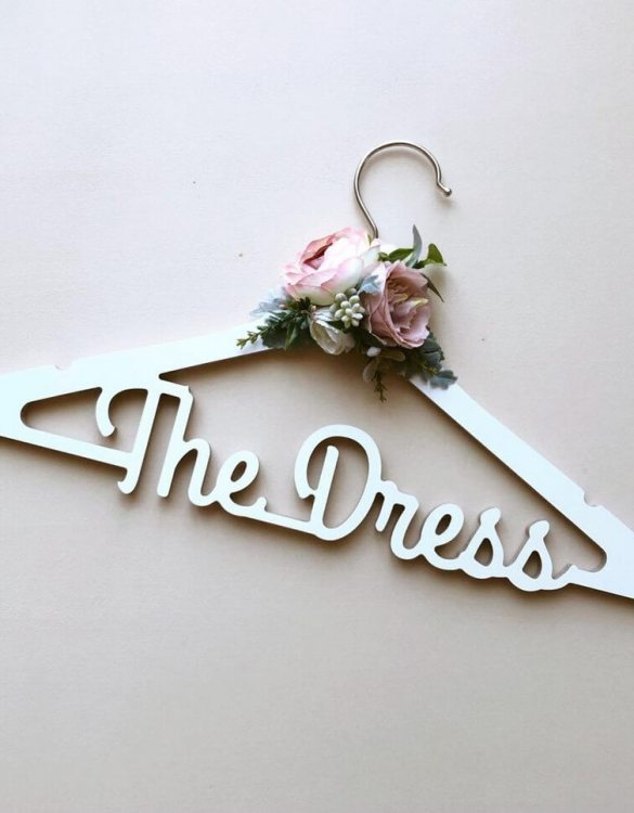 A beautiful way to display tiny clothes and make a wonderful keepsake, the Personalised Floral Bridal Dress Hanger is a lovely little extra for your baby's clothes. A wonderfully unique children's clothes hanger, it is perfect for hanging up their favourite outfit or simply as a wall decoration in their own right.