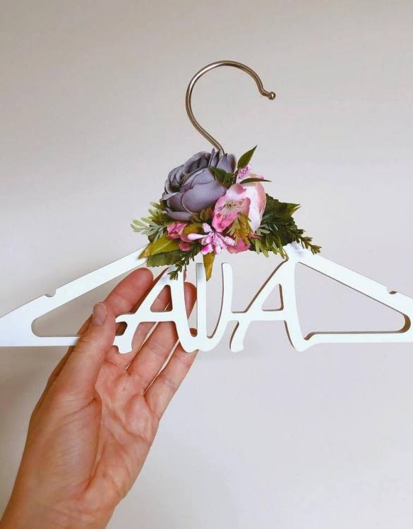 A beautiful way to display tiny clothes and make a wonderful keepsake, the Personalised Flower Girl Dress Hangeris a lovely little extra for your baby's clothes. A wonderfully unique children's clothes hanger, it is perfect for hanging up their favourite outfit or simply as a wall decoration in their own right.