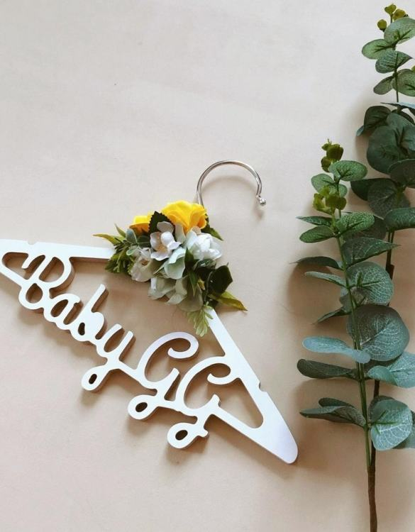 A beautiful way to display tiny clothes and make a wonderful keepsake, the Personalised Kids Flower Clothes Hanger is a lovely little extra for your baby's clothes. A wonderfully unique children's clothes hanger, it is perfect for hanging up their favourite outfit or simply as a wall decoration in their own right.
