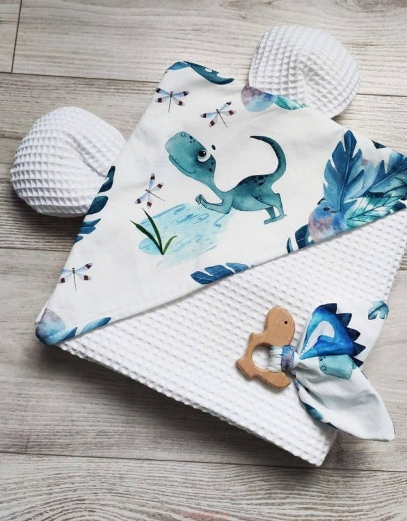A charming towel to wrap your baby with after the bath, the Dinosaurs on Monsters White Hooded Baby Towel makes a very comfortable feel against baby's skin. This unique baby hooded towel is a definite must-have when completing a layette for a baby.