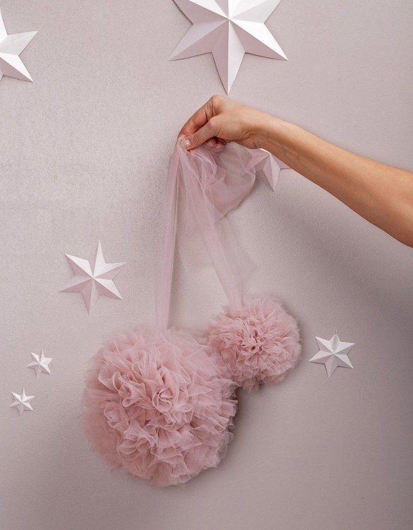 A simple yet effective way to transform your nursery, the Misty Rose Soft Tulle Pom Poms is sure to capture your little one's attention! Whether you hang on your Christmas tree, in a nursery or down your table as a centrepiece, these soft tulle pom poms are perfect for adding some fluffy love to your space.