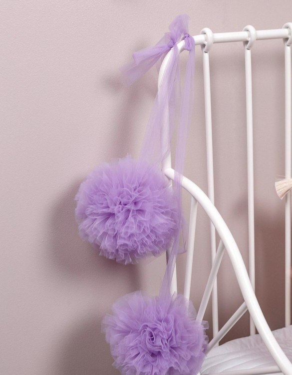 A simple yet effective way to transform your nursery, the Violet Soft Tulle Pom Poms is sure to capture your little one's attention! Whether you hang on your Christmas tree, in a nursery or down your table as a centrepiece, these soft tulle pom poms are perfect for adding some fluffy love to your space.