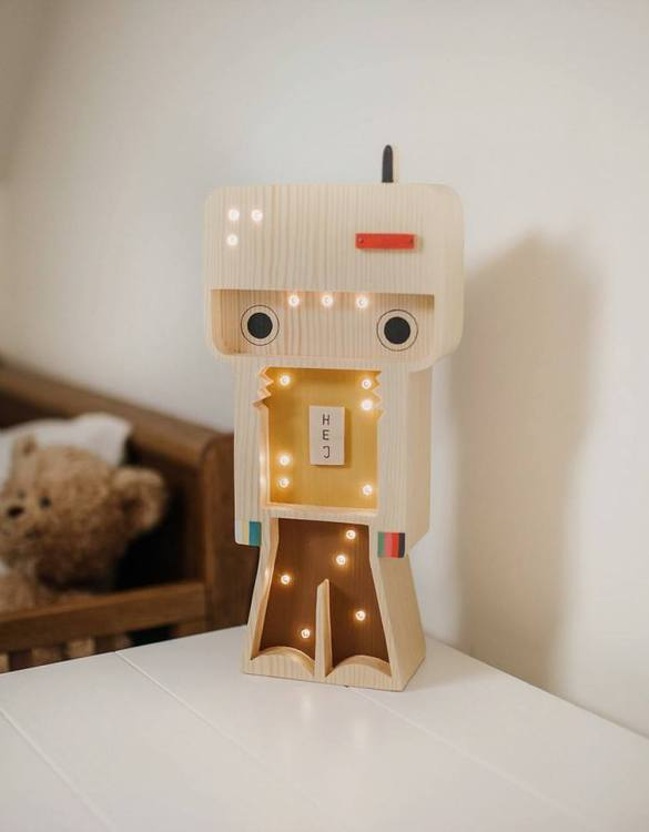 Light up your little one's room with the Wooden Robot Lamp, we think bedtime just got easier! The children's night light will help inspire your kids' love for the outdoors and dreams of big adventures and will help add a sense of calm to your little one's bedroom.