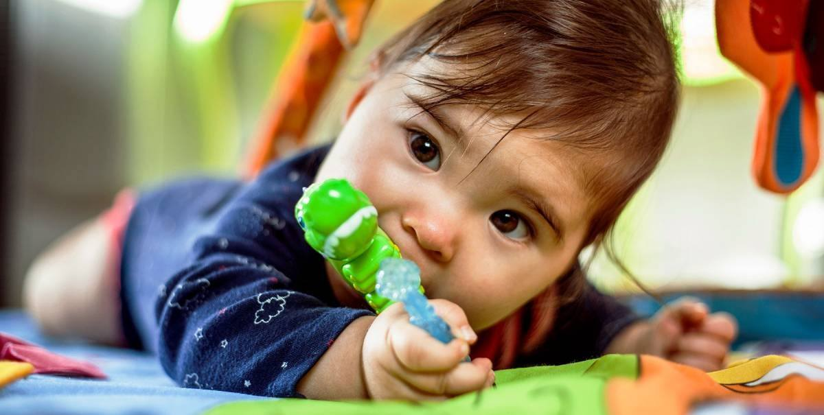 """When your baby's first tooth shows up, you might be taken by surprise (""""Ow! Was that just a bite?""""), or you might just finally understand what all those strange symptoms were about. Look out for these common signs your baby is teething."""