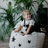 A charming little seat, the Bini with Stars and Black Handle Kid's Beanbag is an ideal solution to create a custom, stylish space for a children's room, youth room, or even a living room.