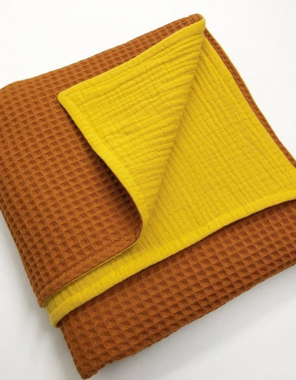 Treat your little one to cosy comfort, the Orange - Ocher Waffle Blanket will keep baby feeling secure and warm, perfect for keeping your baby comfortable when you're out and about. A tender wrap makes your baby feel safe and secure in the big, new world.
