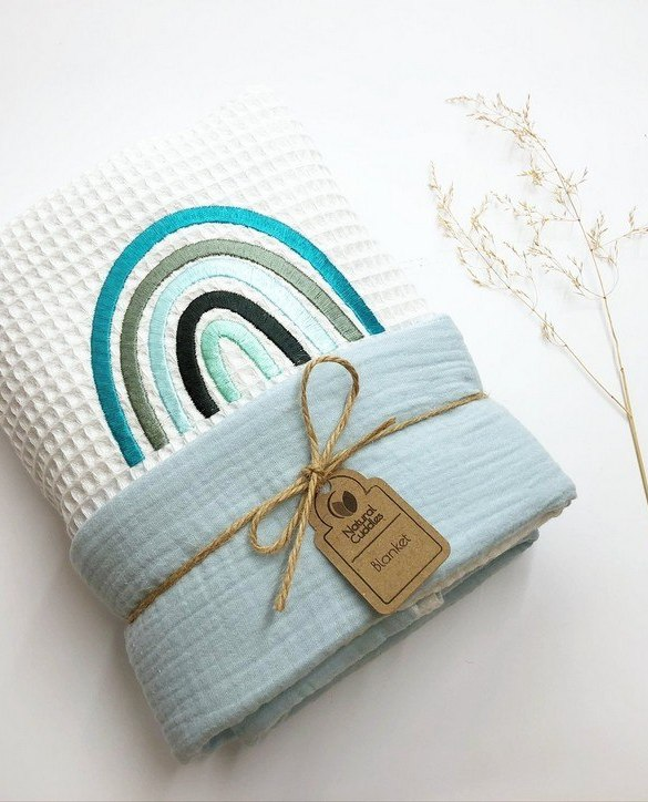 Treat your little one to cosy comfort, the White - Blue Rainbow Waffle Blanket will keep baby feeling secure and warm, perfect for keeping your baby comfortable when you're out and about. A tender wrap makes your baby feel safe and secure in the big, new world.