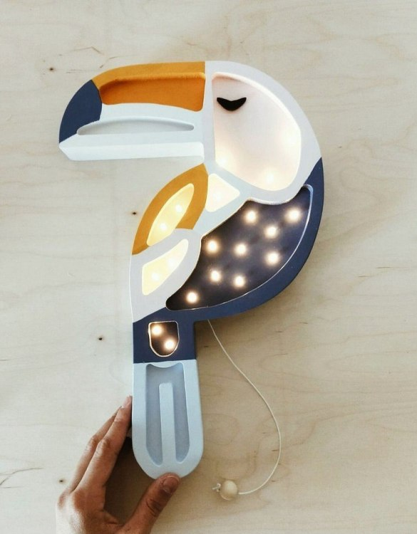 Creating a special and warming atmosphere in your bedroom, the Wooden Toucan Lamp is ideal for a night light or as a gift. This charming Toucan lamp will in an instance take everyone to the colorful tropical world. With its presence and warm light, it will certainly help you fall asleep.