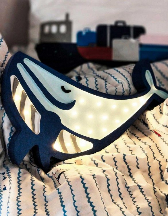 Creating a special and warming atmosphere in your bedroom, the Wooden Whale Lamp is ideal for a night light or as a gift. The Whale lamp is a perfect room accessory for all the ocean and marine wildlife lovers. With its presence and warm light, it will certainly help you fall asleep.