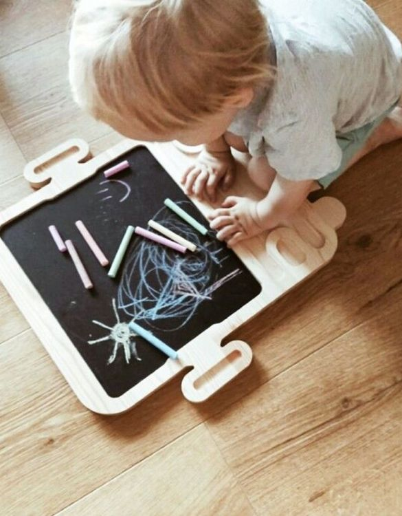 Spark artistic play with the Magnetic Autobus Kids Chalkboard. Just the right height for growing artists, this children's chalkboard encourages creativity and allows little ones to develop their fine motor skills through painting, drawing, coloring, and writing.