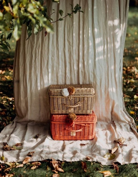 Perfect for storing toys and other treasures, the Rowanberry Wicker Suitcase is a gorgeous storage piece for a child's room. This beautiful small wicker suitcase is an extra special piece to add to a nursery or child's room.
