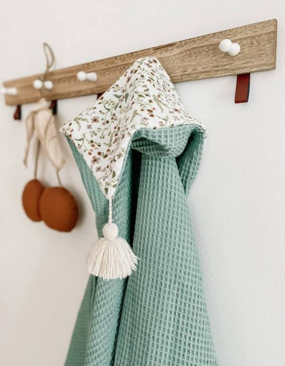 Great for gifting, the Hooded Towel Sage Green Flowers is made from a beautiful 100% cotton terrycloth to make an absorbent yet lightweight fabric. A soft infant hooded towel with a charming muslin hood.