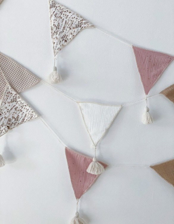 The ideal gift for a new baby or a Christening present, the Triangle Bunting Dusty Pink makes a fab addition to a party or a little one's room. A gentle garland will decorate your nursery room and contribute to the development of the baby.