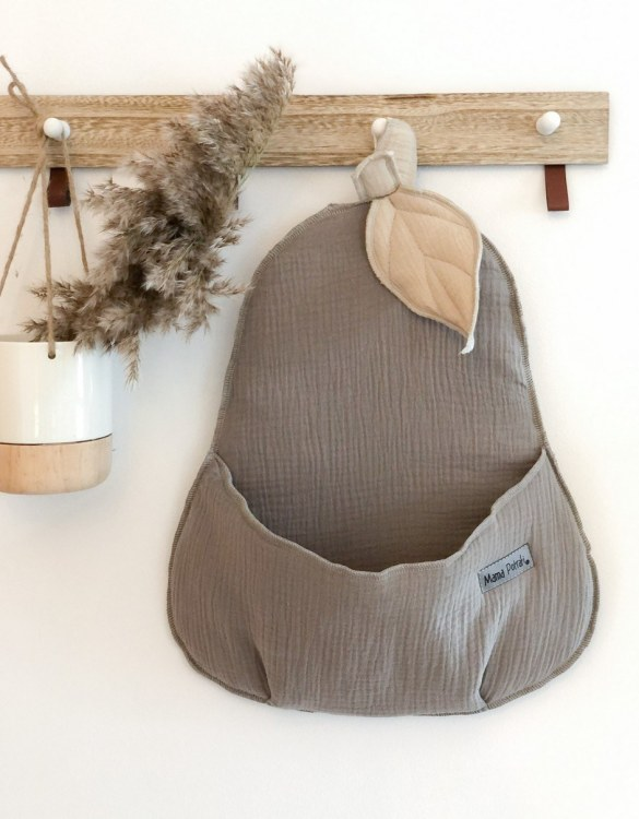 Extremely charming, the Wall Basket Beige Pear will accommodate all your child's trinkets. This wall hanging basket makes the perfect gift for new parents to decorate their little one's room!