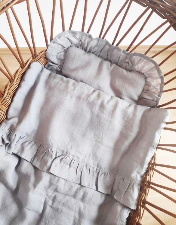 Perfect as a newborn pillow, the Grey Baby Pillow With Ruffle With Ruffle is a great addition for a nursery, children's room, baby crib, or kid's playroom. It makes the perfect gift!