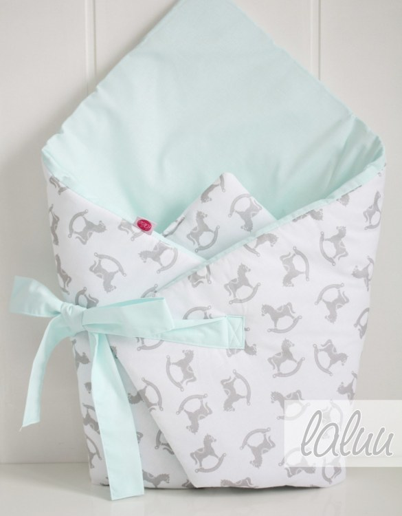A great idea for newborns, the Horses On White and Mint Baby Horn is the perfect accessory for the busy on the go parent. Keeps your baby comfortable with out the hassle of losing dropping or running over your blanket!