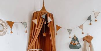Whether your little girl wants to sleep in a glamorous paradise filled with pink and purple or a calming and cozy haven, adding a bed canopy gives her a tiny nook all her own to read and fall asleep under.