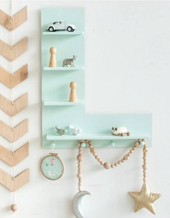 The perfect way to display your treasures, the Mint Letter Children's Wall Shelf is a beautiful addition to any child's bedroom or playroom! Put decorations, stuffed animals or smaller toys on the shelf and get a unique element of a children's room.