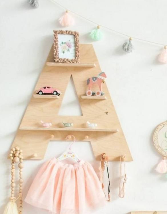 The perfect way to display your treasures, the Natural Letter Children's Wall Shelf is a beautiful addition to any child's bedroom or playroom! Put decorations, stuffed animals or smaller toys on the shelf and get a unique element of a children's room.