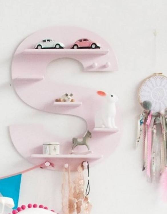 The perfect way to display your treasures, the Pink Letter Children's Wall Shelf is a beautiful addition to any child's bedroom or playroom! Put decorations, stuffed animals or smaller toys on the shelf and get a unique element of a children's room.
