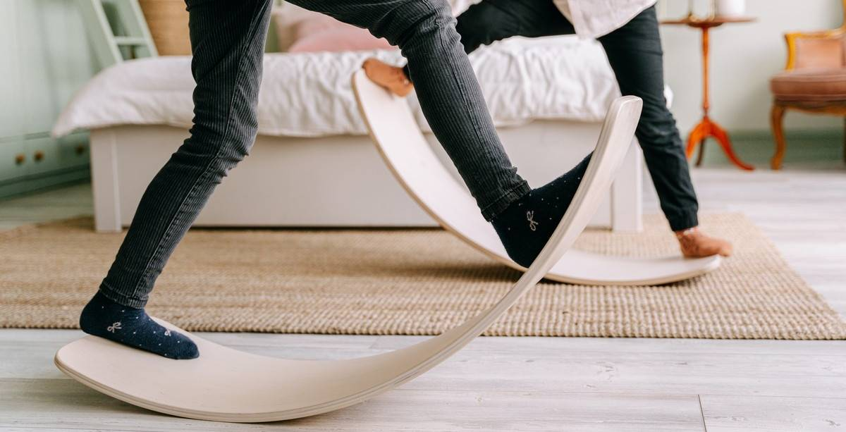 A balance board is a relatively safe way to help a child get used to Vestibular input. All that your child really needs to do is to stand on it. Then, they will shift their body weight and respond appropriately to the changing stimuli.