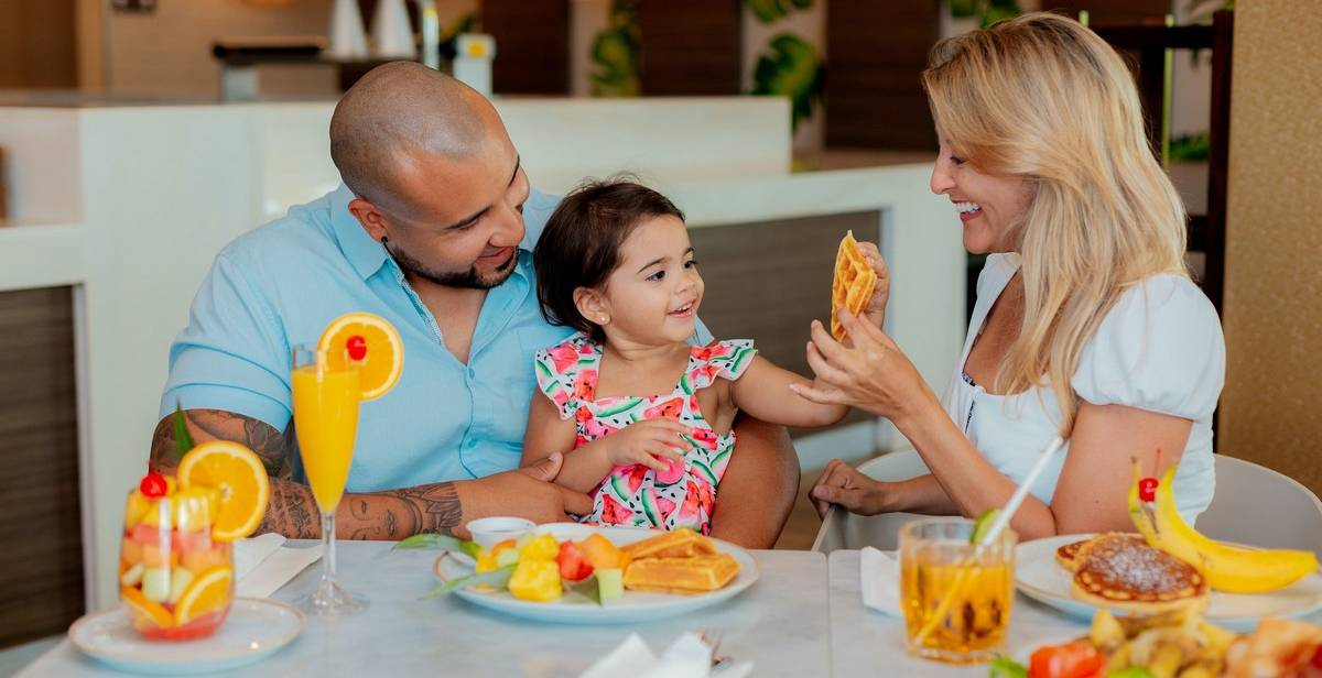 Although there is no specific age, your toddler will typically be ready to move away from the high chair between 18 months and 3 years of age. During this range, they're steady enough to keep themselves upright for longer periods of time, but may still be a bit wiggly.