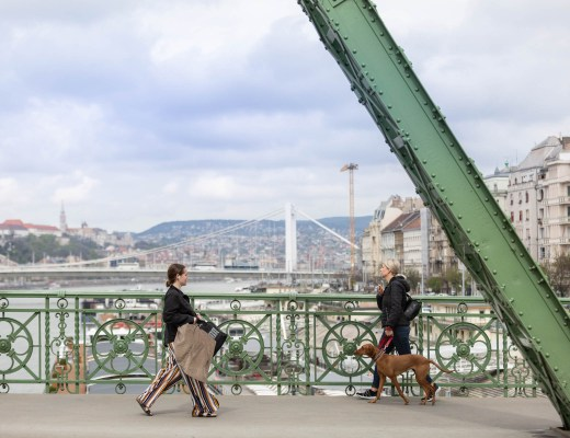 Featured Image: two local women walking across one of the main bridges in Budapest