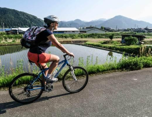 Me cycling through beautiful green rice fields in Japan.
