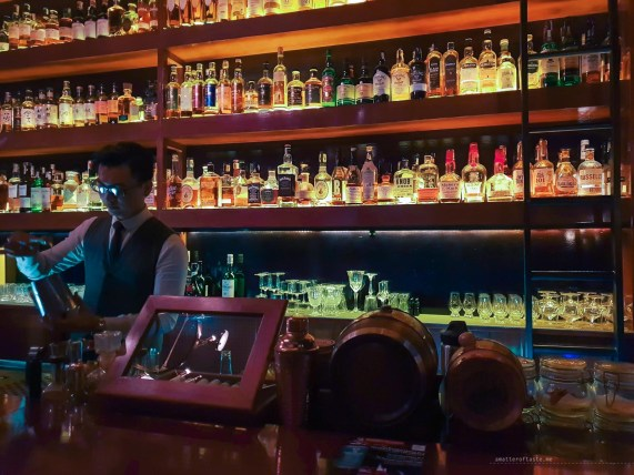 Part of the bar with the huge collection of whiskey.