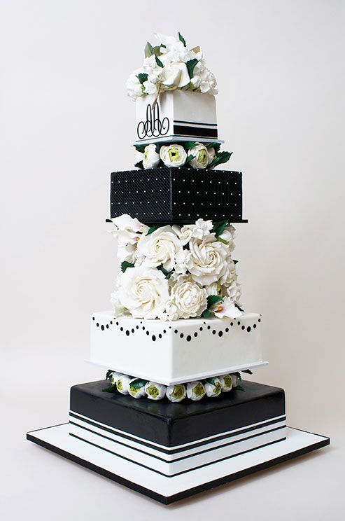 A black and white wedding cake is a classic option for a formal     A black and white wedding cake is a classic option for a formal black tie  reception