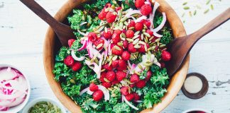 This Winter Kale Salad with Raspberry Vinaigrette recipe is easy to make, healthy and totally delicious. A crowd pleaser that truly goes with any dish!