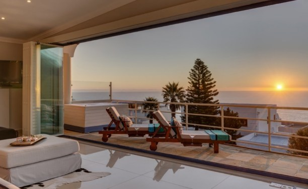Beautiful balcony view in which you can see the amazing golden sunset over the ocean by our luxury villa.