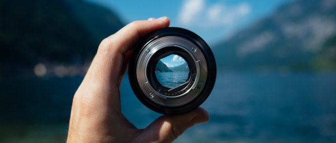 a camera lens focusing on mountains