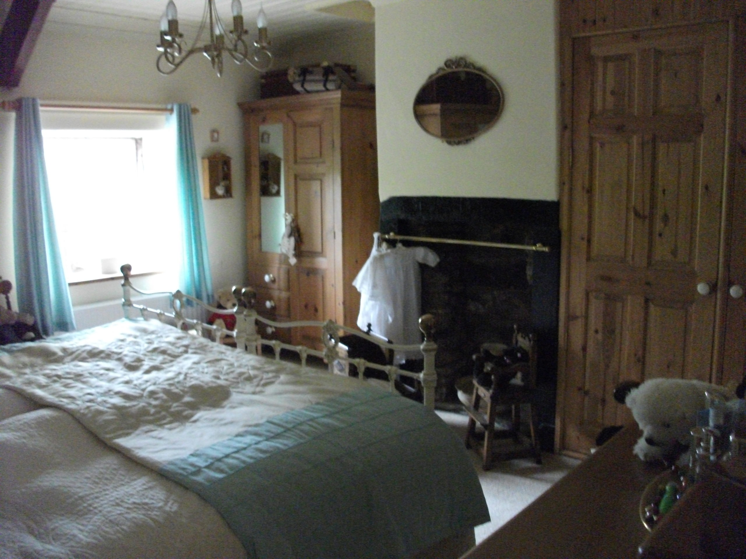 Poor quality image of master bedroom in 2010