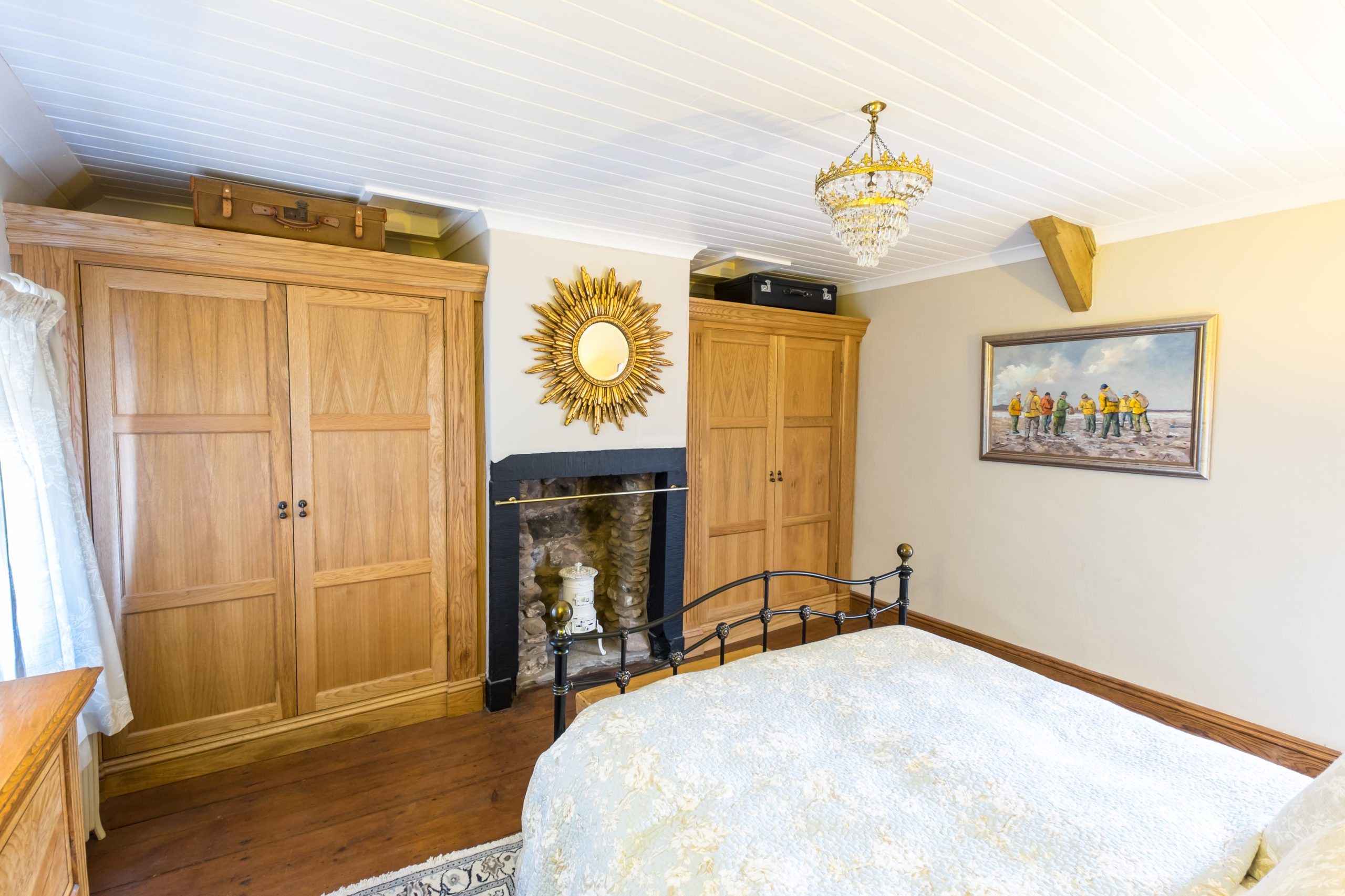 Oak wardrobes in Georgian cottage designed by Amelia Wilson