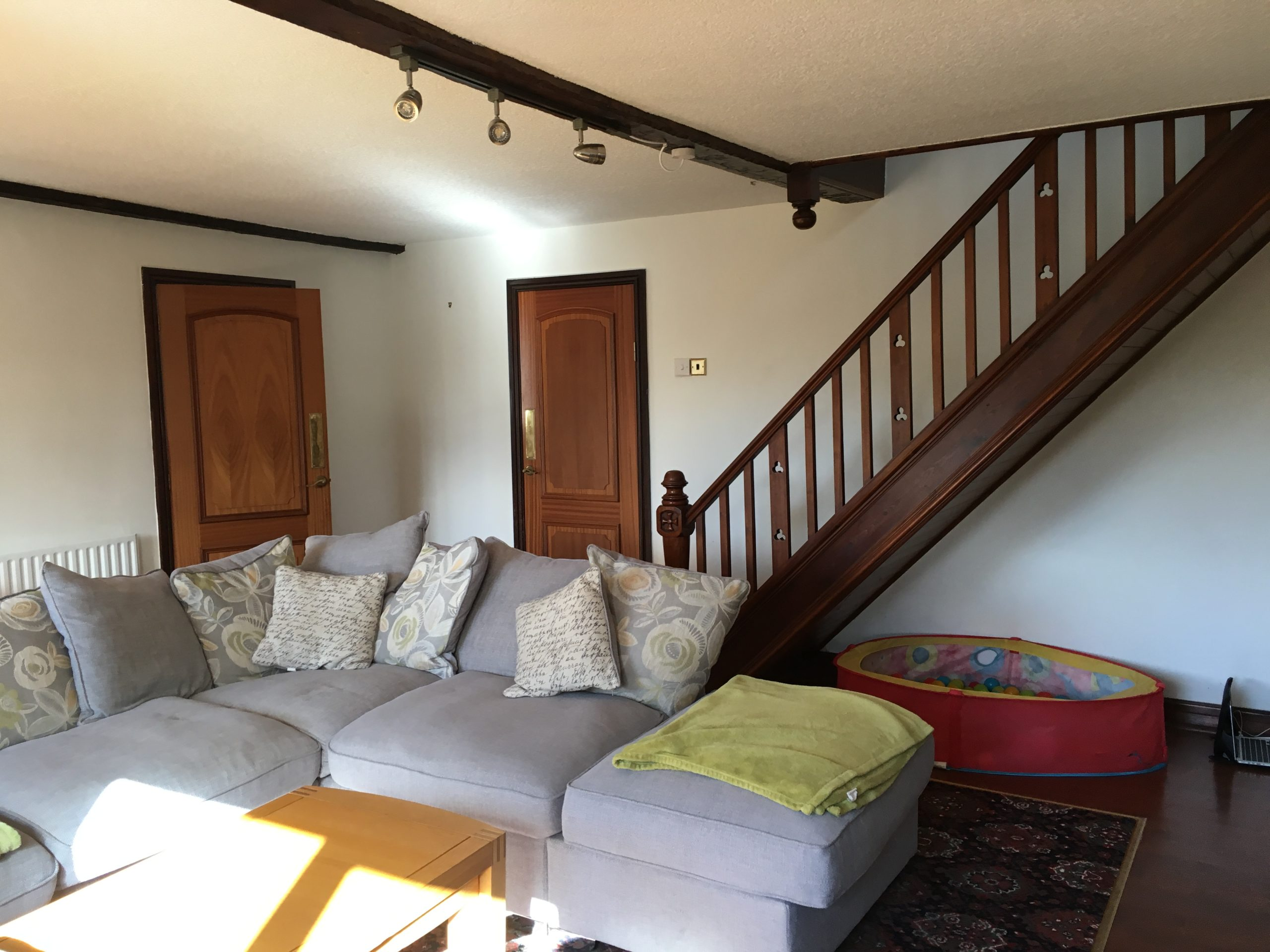TV room - before image of the snug designed by Amelia Wilson Interiors Ltd