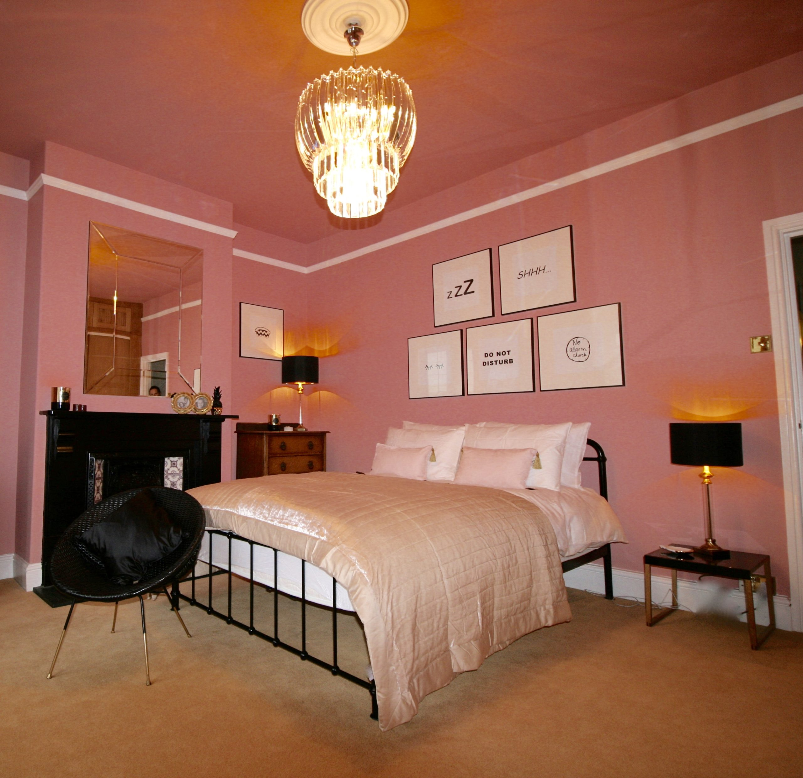 Pink bedroom with black metal and gold by Amelia Wilson Interiors Ltd