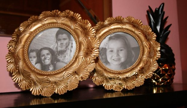 Round gold picture frames and black and gold pineapple from Homesense